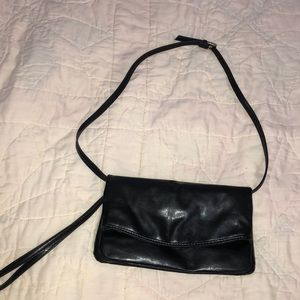 Black clutch with removable long strap.